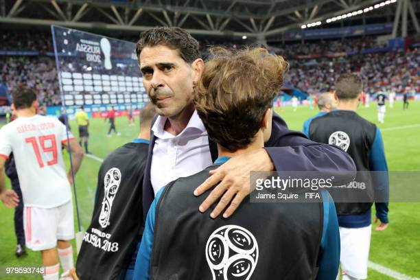 Fernando Hierro Head coach of Spain celebrates with Alvaro Odriozola of Spain following their sides victory in the 2018 FIFA World Cup Russia group B...