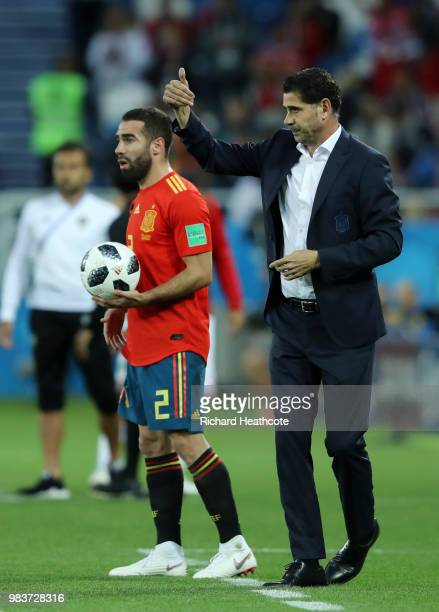 Fernando Hierro Head coach of Spain gives thumbs up as Dani Carvajal prepares to take a throwin during the 2018 FIFA World Cup Russia group B match...