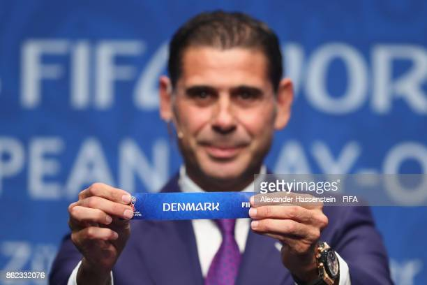 Fernando Hierro holds up the name of Denmark during the Official Draw for the 2018 FIFA World Cup European PlayOff at the FIFA headquaters on October...