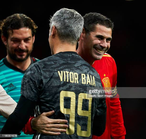 Fernando Hierro of Spanish National Team Legends salutes with Victor Baia of Goldstandard during a frienly match at Wanda Metropolitano on December...