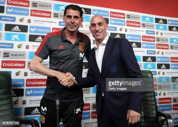 Fernando Hierro shakes hands with Luis Manuel Rubiales after he was appointed the new head coach of Spain during the Spain Press Conference ahead of...