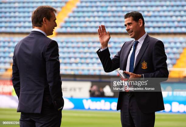 Fernando Hierro sporting director of Spain talks to Julen Lopetegui manager of Spain prior to the International Friendly match between Spain and...
