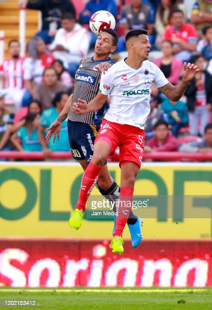 Fernando Leon of San Luis fights for the ball with Mauro Quiroga of Necaxa during the 3rd round match between Necaxa and Atletico San Luis as part of...