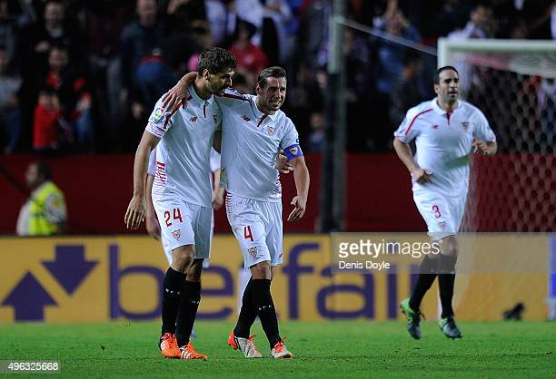 Fernando Llorente and Grzegorz Krychowiak of Sevilla FC celebrate after Sevilla scored their 3rd goal during the La Liga match between Sevilla FC and...