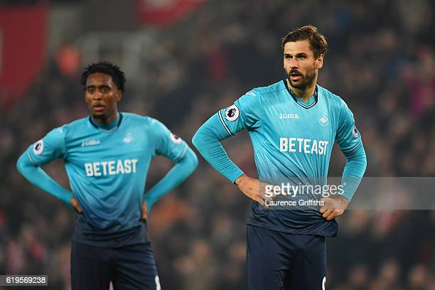 Fernando Llorente and Leroy Fer of Swansea City look thoughtful during the Premier League match between Stoke City and Swansea City at Bet365 Stadium...