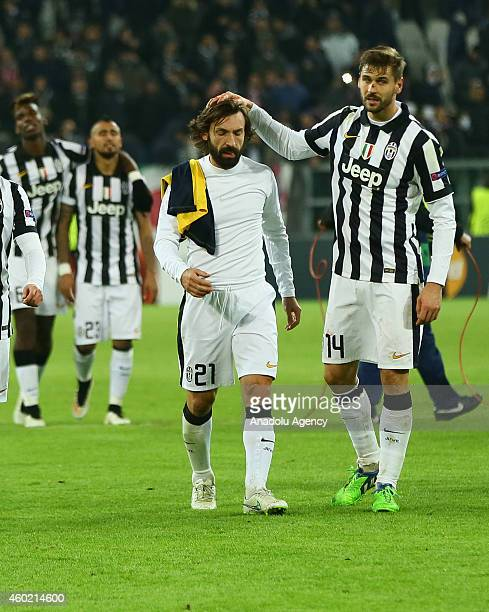 Fernando Llorente and Pirlo of Juventus celebrate after the Champions League Group A football match between Juventus and Atletico Madrid at the...