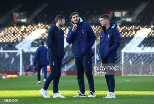 Fernando Llorente Ben Davies and Juan Foyth of Tottenham inspect the pitch during the Premier League match between Fulham FC and Tottenham Hotspur at...