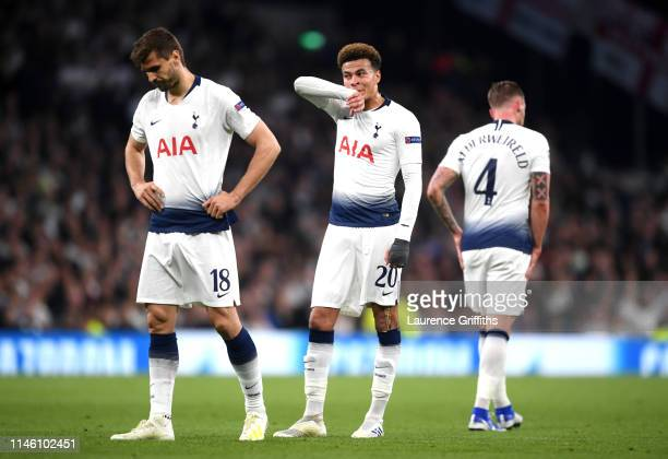 Fernando Llorente Dele Alli and Toby Alderweireld of Tottenham Hotspur look despondent during the UEFA Champions League Semi Final first leg match...