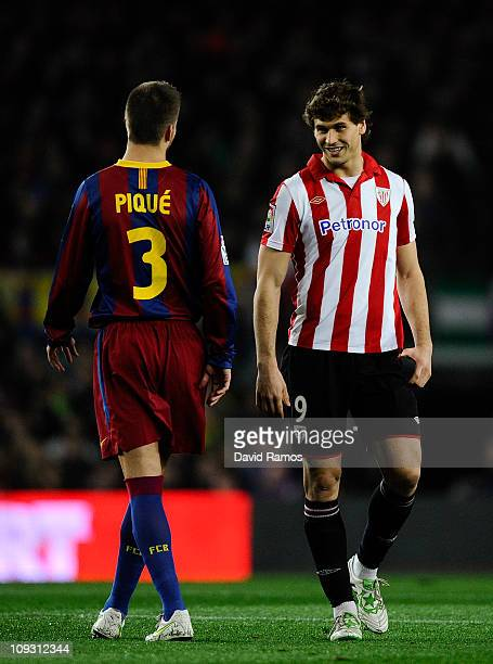 Fernando Llorente of Athletic Bilbao and Gerard Pique of FC Barcelona share a joke during the La Liga match between FC Barcelona and Athletic Bilbao...