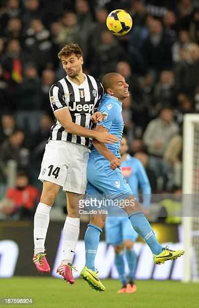 Fernando Llorente of Juventus and Gokhan Inler of SSC Napoli compete for the ball during the Serie A match between Juventus and SSC Napoli at...