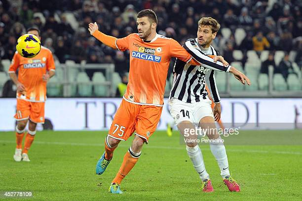 Fernando Llorente of Juventus competes with Thomas Heurtaux of Udinese Calcio during the Serie A match between Juventus and Udinese Calcio at...
