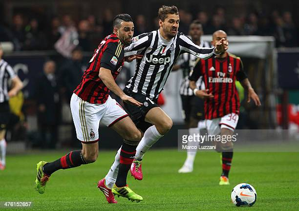 Fernando Llorente of Juventus FC competes for the ball with Adil Rami of AC Milan during the Serie A match between AC Milan and Juventus at San Siro...