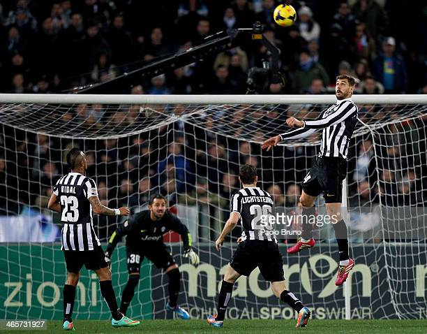 Fernando Llorente of Juventus in action as his teammates watch him during the Serie A match between SS Lazio and Juventus at Stadio Olimpico on...