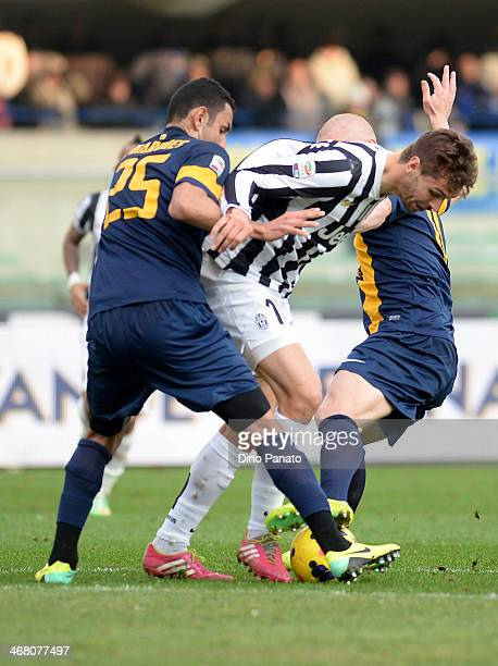 Fernando Llorente of Juventus is challenged to Rafael Marques Pinto and Emil Hallfredsson of Hellas Verona during the Serie A match between Hellas...