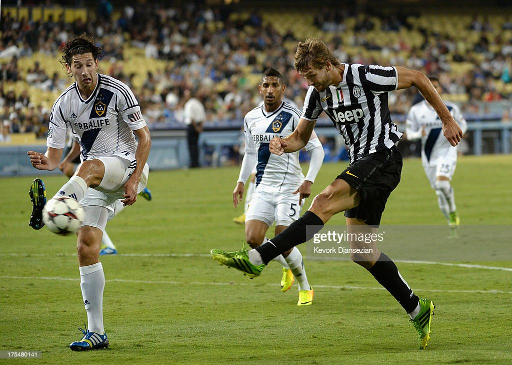 Fernando Llorente #14 of Juventus takes a shot on goal as Omar Gonzalez #4 of the Los Angeles Galaxy defends during the second half of the 2013 Guinness International Champions Cup at Dodger Stadium on August 3, 2013 in Los Angeles, California