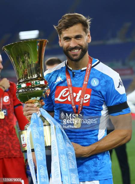 Fernando Llorente of Napoli celebrates with the trophy during the Coca Cola Italian Cup Final football match SSC Napoli v Fc Juventus at the Olimpico...
