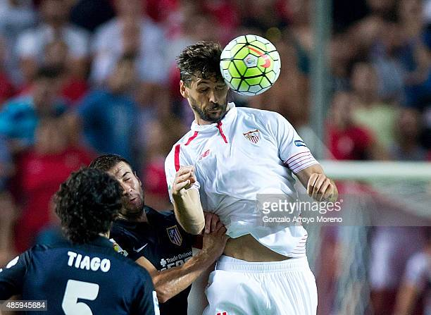 Fernando Llorente of Sevilla FC wins the header after Gabi Fernandez of Atletico de Madrid during the La Liga match between Sevilla FC and Club...