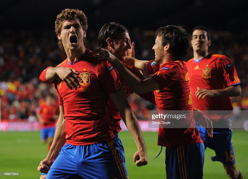 Fernando Llorente (L) of Spain celebrates after scoring his team's first goal during the EURO 2012 Qualifying Group I match between Spain and Lithuania at the Helmantico stadium on October 8, 2010 in Salamanca, Spain.