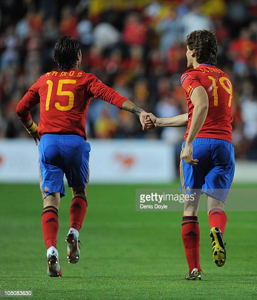 Fernando Llorente of Spain celebrates with Sergio Ramos after scoring his team's first goal during the EURO 2012 Qualifying Group I match between...