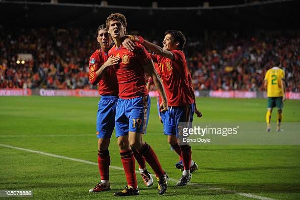 Fernando Llorente of Spain celebrates with Sergio Ramos and David Silva after scoring his team's first goal during the EURO 2012 Qualifying Group I...