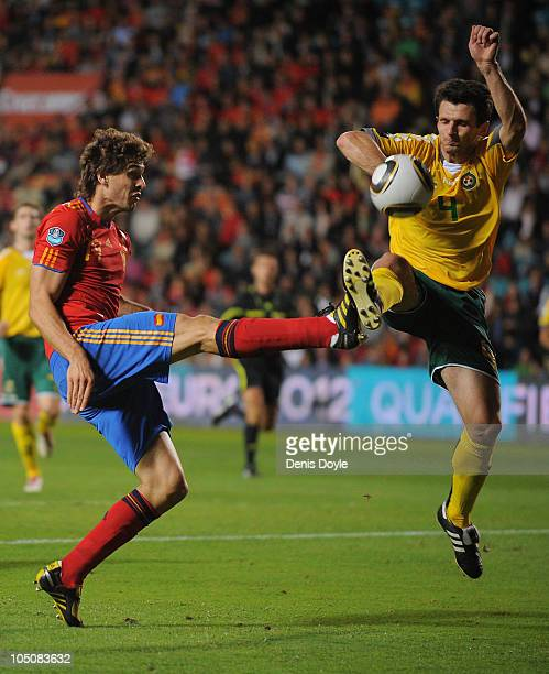 Fernando Llorente of Spain in action against Tadas Kijanskas of Lithuania during the EURO 2012 Qualifying Group I match between Spain and Lithuania...