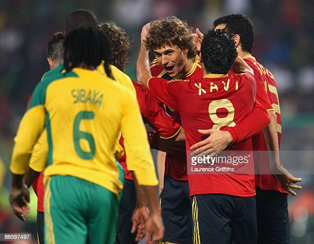 Fernando Llorente of Spain is congratulated on scoring the second goal by Xavi during the FIFA Confederations Cup match between Spain and South...