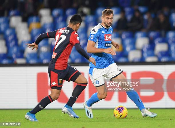 Fernando Llorente of SSC Napoli vies with Cristian Romero of Genoa CFC during the Serie A match between SSC Napoli and Genoa CFC at Stadio San Paolo...