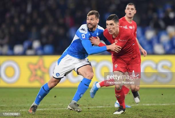 Fernando Llorente of SSC Napoli vies with Nikola Milenkovic of ACF Fiorentina during the Serie A match between SSC Napoli and ACF Fiorentina at...
