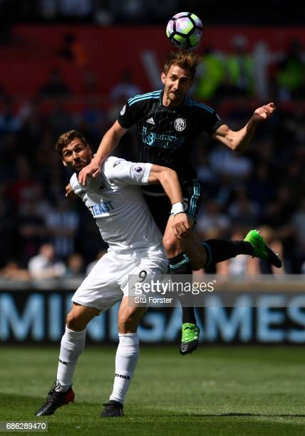 Fernando Llorente of Swansea City and Craig Dawson of West Bromwich Albion battle to win a header during the Premier League match between Swansea...