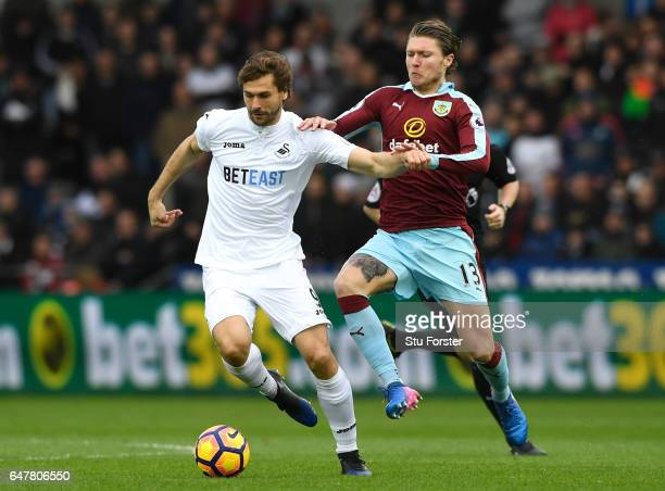 Fernando Llorente of Swansea City and Jeff Hendrick of Burnley battle for possession during the Premier League match between Swansea City and Burnley...