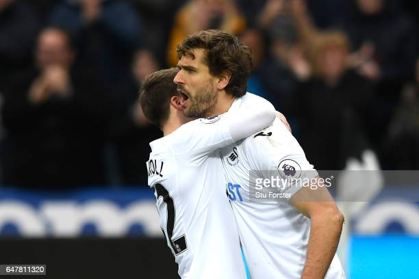 Fernando Llorente of Swansea City celebrates scoring his sides first goal with Tom Carroll of Swansea City during the Premier League match between...
