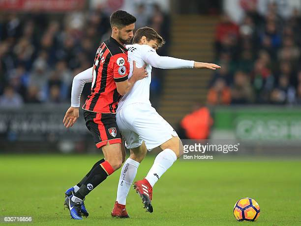 Fernando Llorente of Swansea City controls the ball under pressure of Andrew Surman of AFC Bournemouth during the Premier League match between...