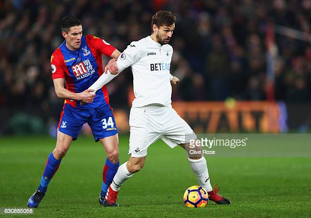 Fernando Llorente of Swansea City controls the ball under pressure of Martin Kelly of Crystal Palace during the Premier League match between Crystal...