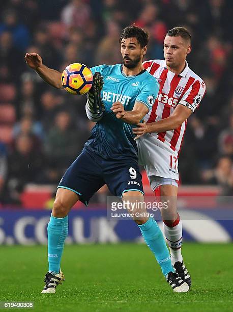 Fernando Llorente of Swansea City is challenged by Ryan Shawcross of Stoke City during the Premier League match between Stoke City and Swansea City...