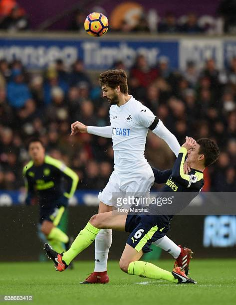 Fernando Llorente of Swansea City is tackled by Laurent Koscielny of Arsenal during the Premier League match between Swansea City and Arsenal at...