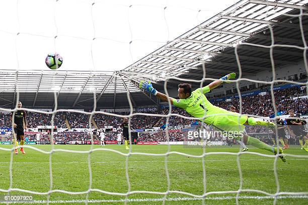 Fernando Llorente of Swansea City scores his sides first goal during the Premier League match between Swansea City and Manchester City at the Liberty...