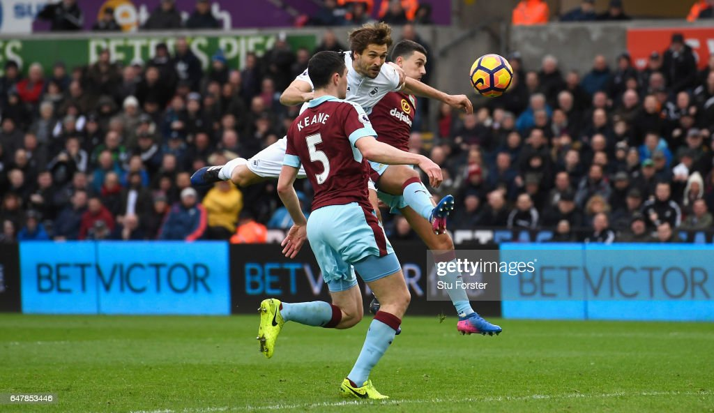 Fernando Llorente of Swansea City (C) scores his sides first goal during the Premier League match between Swansea City and Burnley at Liberty Stadium on March 4, 2017 in Swansea, Wales.