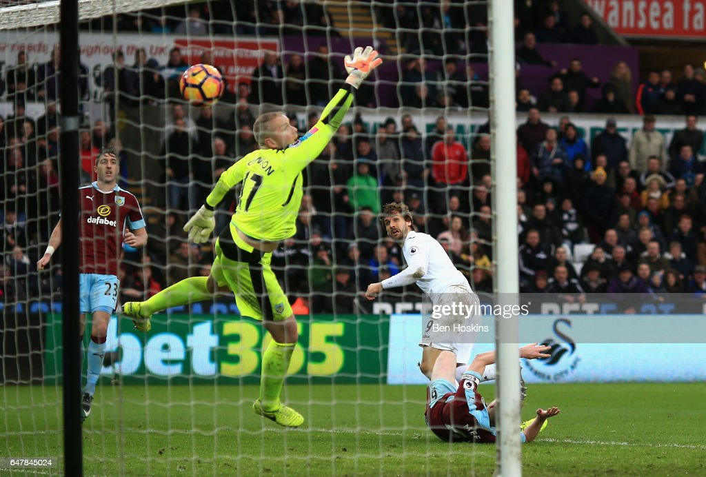 Fernando Llorente of Swansea City (R) scores his sides third goal past Paul Robinson of Burnley (L) during the Premier League match between Swansea City and Burnley at Liberty Stadium on March 4, 2017 in Swansea, Wales.