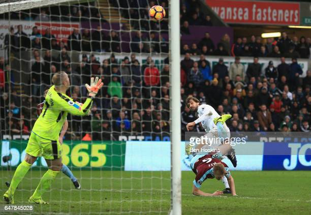 Fernando Llorente of Swansea City scores his sides third goal past Paul Robinson of Burnley during the Premier League match between Swansea City and...
