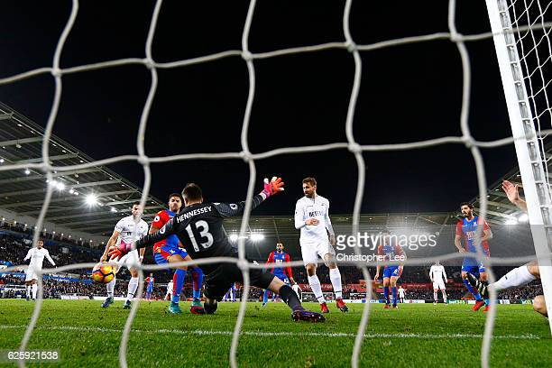 Fernando Llorente of Swansea City scores his team's fifth goal past Wayne Hennessey of Crystal Palace during the Premier League match between Swansea...