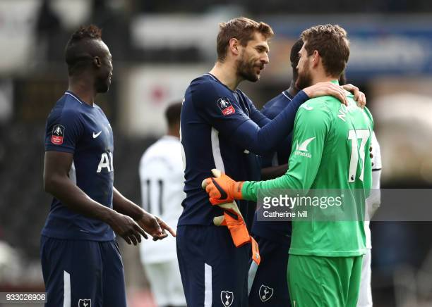 Fernando Llorente of Tottenham Hotspur and Kristoffer Nordfeldt of Swansea City embrace after The Emirates FA Cup Quarter Final match between Swansea...