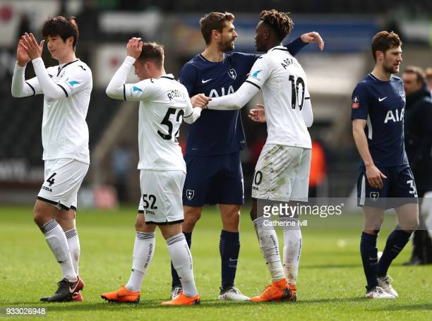 Fernando Llorente of Tottenham Hotspur and Tammy Abraham of Swansea City embrace after the Emirates FA Cup Quarter Final match between Swansea City...
