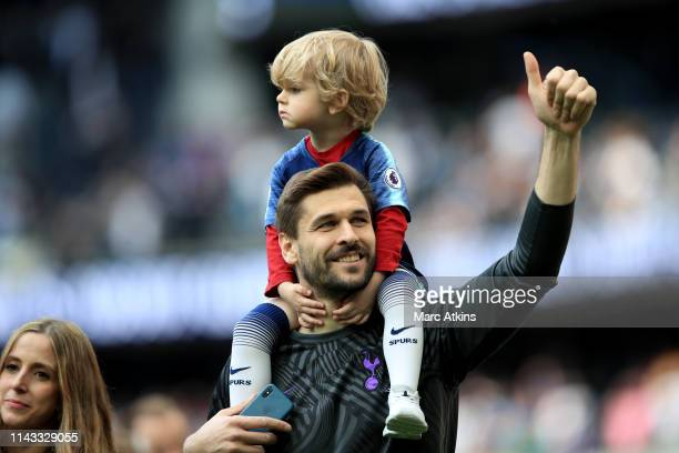 Fernando Llorente of Tottenham Hotspur carries his child on his shoulders as he gives a thumbs up during the Premier League match between Tottenham...