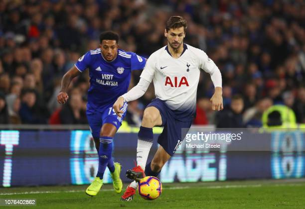 Fernando Llorente of Tottenham Hotspur evades Nathaniel MendezLaing of Cardiff City during the Premier League match between Cardiff City and...
