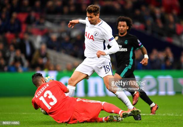 Fernando Llorente of Tottenham Hotspur is foiled by Kiko Casilla of Real Madrid during the UEFA Champions League group H match between Tottenham...