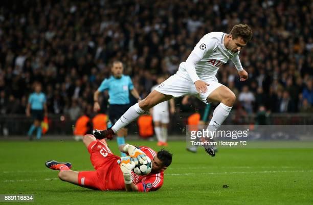 Fernando Llorente of Tottenham Hotspur jumps over Francisco Casilla of Real Madrid during the UEFA Champions League group H match between Tottenham...