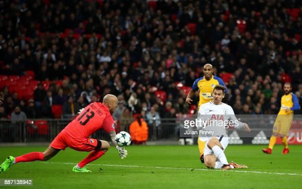 Fernando Llorente of Tottenham Hotspur scores his sides first goal past Nauzet Perez of Apoel FC during the UEFA Champions League group H match...