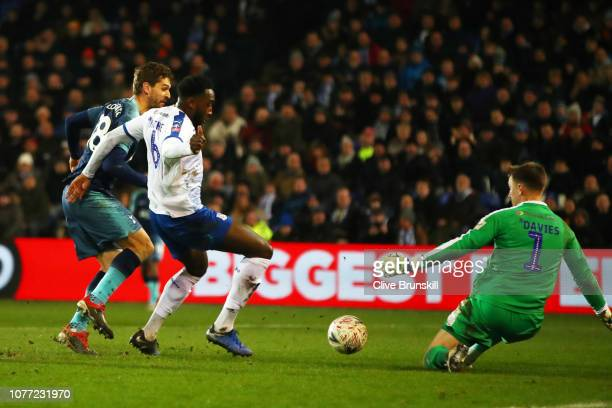 Fernando Llorente of Tottenham Hotspur scores his team's fifth goal past Manny Monthe of Tranmere Rovers and Scott Davies of Tranmere Rovers during...