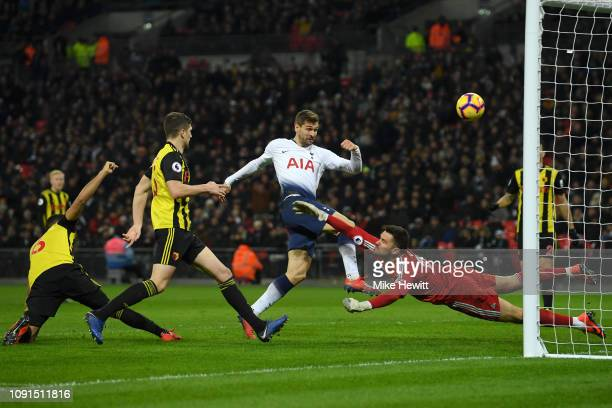 Fernando Llorente of Tottenham Hotspur shoots and misses from close range under pressure from Ben Foster of Watford during the Premier League match...