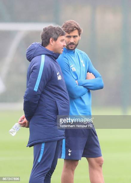 Fernando Llorente talks to coach Miguel D'Agostino during the Tottenham Hotspur Training Session atTottenham Hotspur Training centre on October 26...